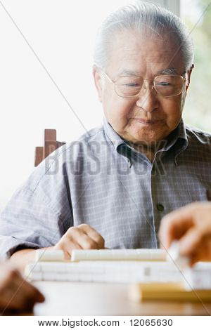Elderly man playing game