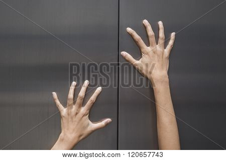 Woman Hands Try To Stop Doors Of The Closed Elevator
