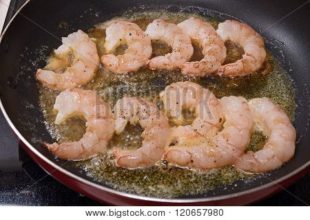 Shrimps on a skillet. Process of cooking