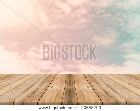 Vintage wooden board empty table in front of sky background. Perspective wood floor over sky - can be used for display or montage your products. Vintage filter.
