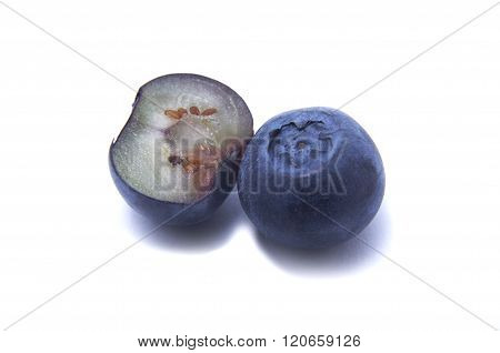 Sliced Blueberry And One Blueberry With Clipping Path