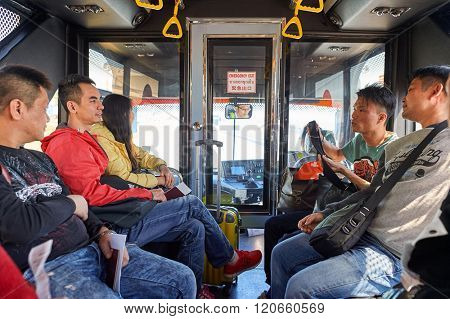 PATTAYA, THAILAND - FEBRUARY 26, 2016: passengers in the bus at U-Tapao International Airport. U-Tapao Rayong -Pattaya International Airport is serving Rayong and Pattaya cities in Thailand.