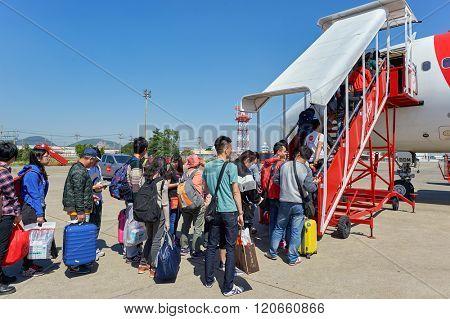 PATTAYA, THAILAND - FEBRUARY 26, 2016: people boarding Thai AirAsia A320 at U-Tapao International Airport. U-Tapao Rayong -Pattaya International Airport is serving Rayong and Pattaya cities