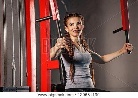 Girl Exercising At A Sports Simulator.