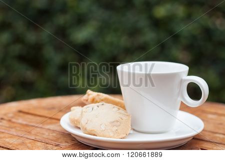 Cashew cookies with coffee cup, stock photo
