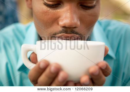 Close up of man drinking coffee