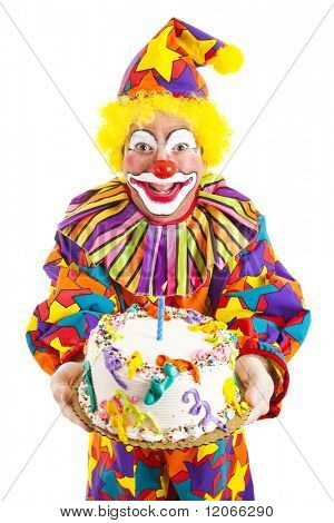 Colorful clown holding a birthday cake.  Isolated on white.