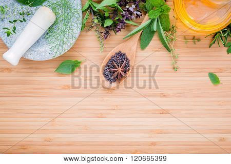 Assortment of herbs set up with wooden background concept for international cuisine.
