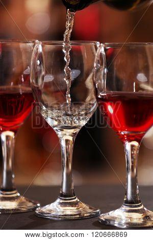 White wine pouring into wine glass, closeup