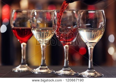 Red wine pouring into wine glass, closeup