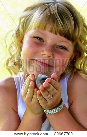 Painting Of Adorable Little Blond Girl Holding Her Hamster