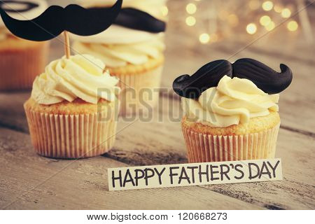 Happy fathers day special cupcakes on wooden table