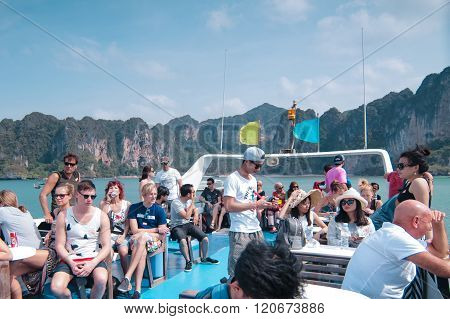 Tourist At Top Of A Boat
