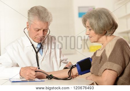 Elderly doctor measuring