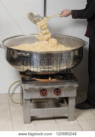 chef cooking rice at a commercial kitchen