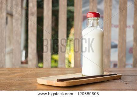 Bottle Of Milk On Wooden Table