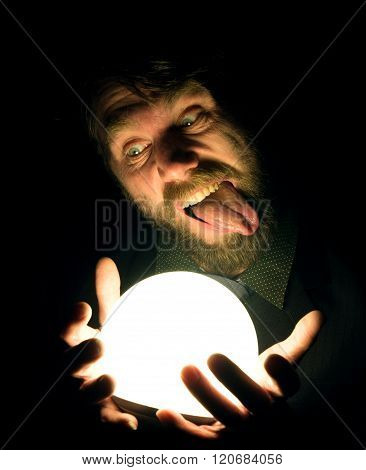 bearded man in the dark, holding in front of a lamp, expresses different emotions