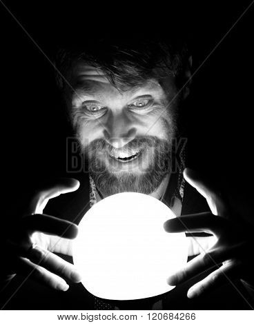 black and white, bearded man in the dark, holding in front of a lamp, expresses different emotions