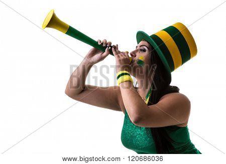 Brazilian woman fan blowing by vuvuzela on white background