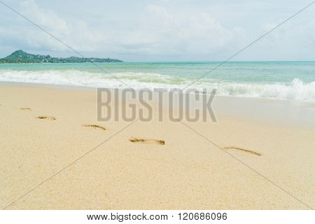 Thai beach, wave and footsteps