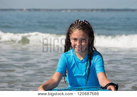 Young Cute Girl Bodyboards On Surfboard With Nice Smile