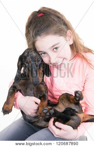 Portrait Of A Beautiful Young Girl Snuggling With  Cute Dog