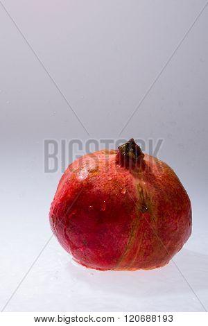 Closeup Of Whole Pomegranate