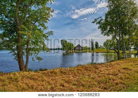 Abstract view of Russian Village Countryside with wooden house at the background