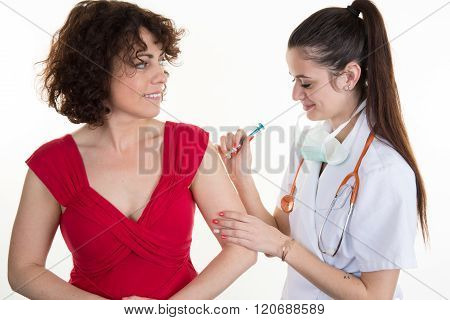 Vaccination - Female Doctor With A Syringe Give An Injection