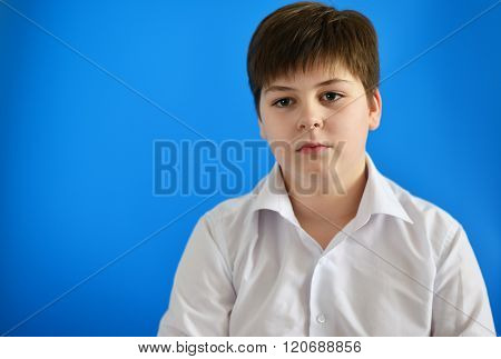 Portrait of teenage boy on the blue background