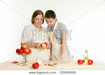 The Grandmother And The Granddaughter Cut Off A Peel From Apple