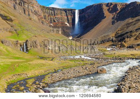 The Hengifoss waterfall in Iceland in the distance