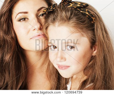 bright picture of hugging mother and daughter happy together, smiling stylish family.