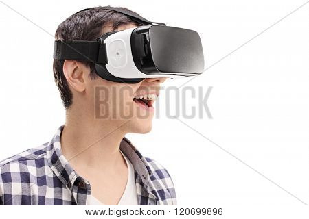 Young man using a VR headset and experiencing virtual reality isolated on white background