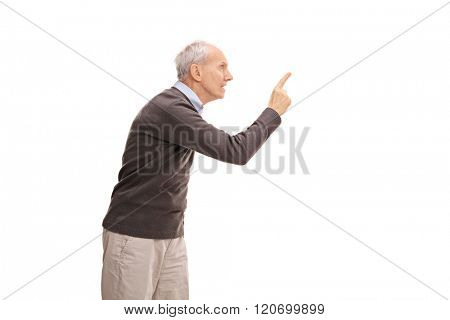 Studio shot of a senior gentleman disciplining someone isolated on white background