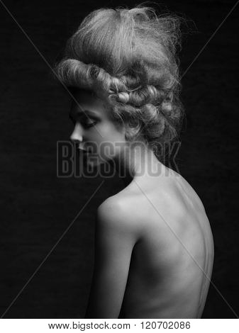 Fashion studio portrait of young beautiful woman with retro victorian hairstyle