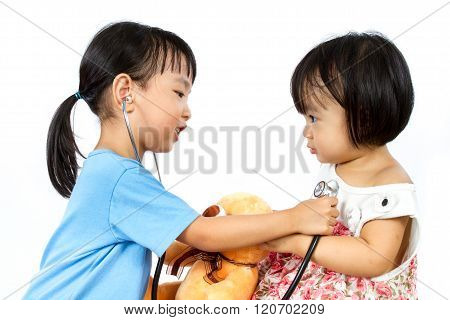 Asian Little Chinese Girls Playing As Doctor And Patient With Stethoscope