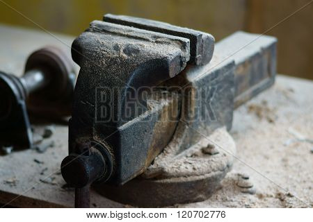 vintage vice tool on the working table