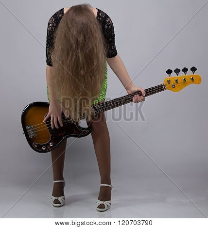Teenage girl with guitar, headbang