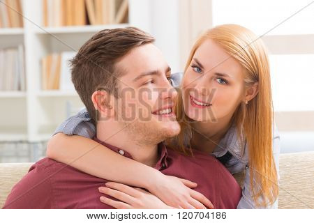 Smiling young woman loving her hearing impairment man