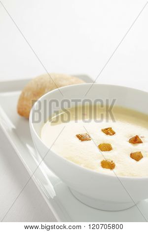 Photos of spicy parsnip soup on white background