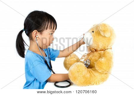 Asian Little Chinese Girl Playing Doctor With Teddy Bear