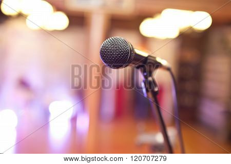 Close-up Of A Microphone In A Concert Hall On The Background Of Blurred Lights