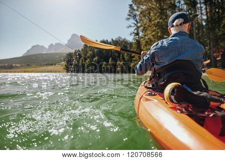 Man Canoeing In A Lake
