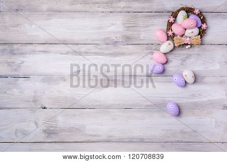 Easter Eggs In Nest On Wooden Background.