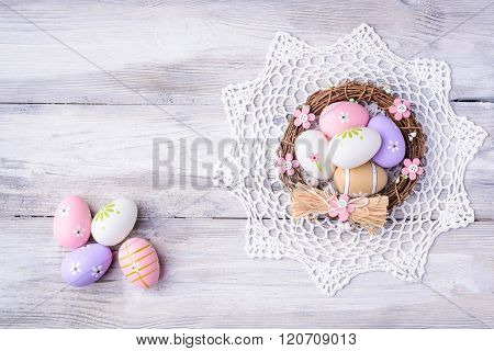 Colorful Easter Eggs With White Serviette And Nest