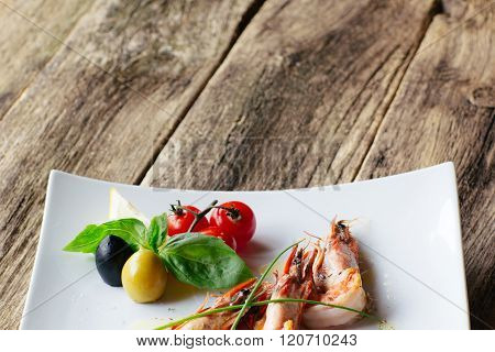 Mediterranean cuisine. shrimps and vegetables