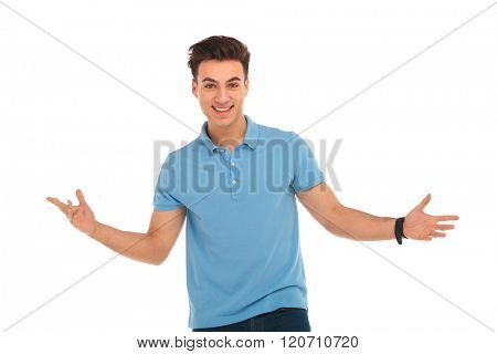 close portrait of man posing in isolated studio background with arms wide open while looking at the camera