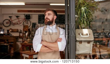 Barista Standing At Doorway Of A Cafe