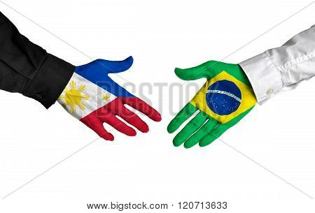 Philippines and Brazil leaders shaking hands on a deal agreement